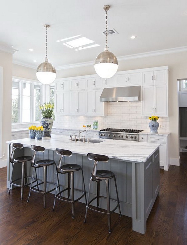 Classic white kitchen with white cabinets, darker floors,gray island and the modern pendants. More via https://forcreativejuice.com/elegant-white-kitchen-interior-designs/