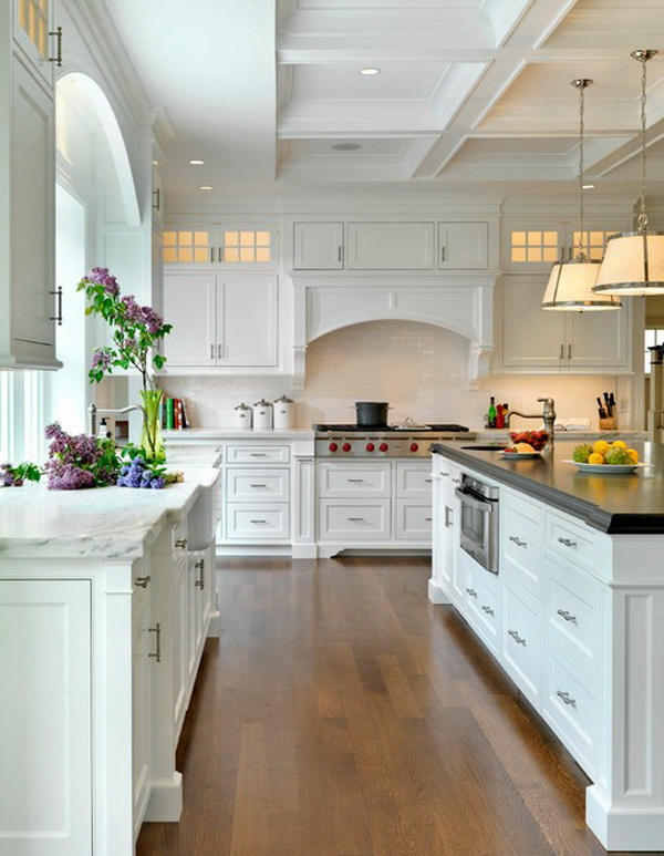 Traditional white kitchen with a farmhouse sink, marble countertops, white cabinets, beaded inset cabinets, white backsplash and subway tile backsplash. More via https://forcreativejuice.com/elegant-white-kitchen-interior-designs/