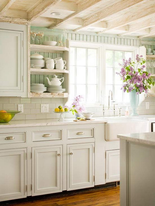 Cottage style white kitchen with soft green beaded wall and vintage wood beams. More via https://forcreativejuice.com/elegant-white-kitchen-interior-designs/