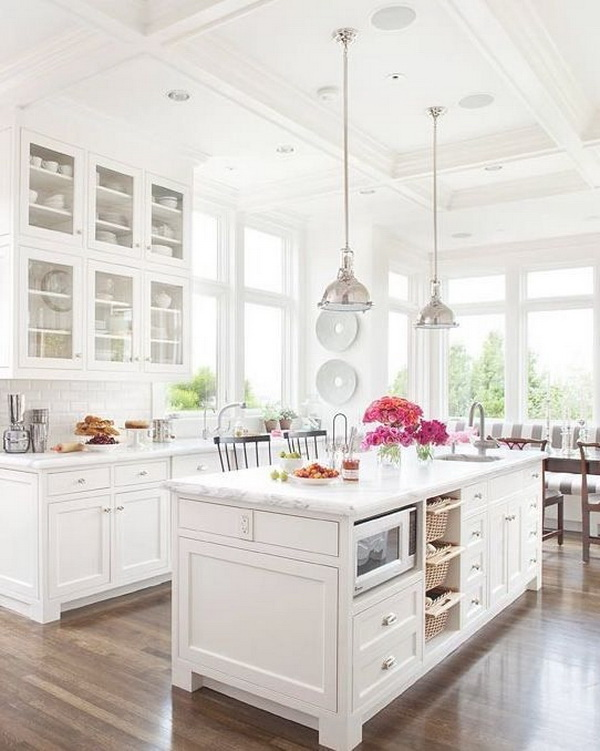 All-white kitchen with white tiles, white cabinets, marble counters, and tall ceilings, this kitchen looks calm, cool, and collected.More via https://forcreativejuice.com/elegant-white-kitchen-interior-designs/