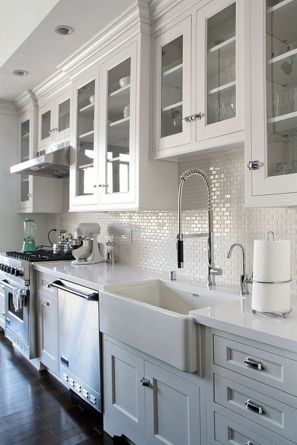 Beautiful white kitchen with farmhouse sink and white cabinets some with glass fronts. More via https://forcreativejuice.com/elegant-white-kitchen-interior-designs/
