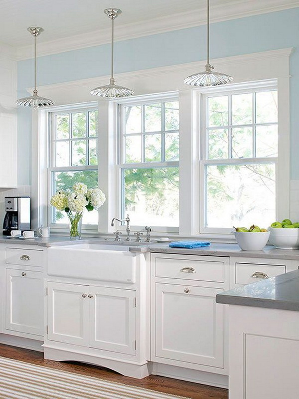 Bright white kitchen with the large windows. More via https://forcreativejuice.com/elegant-white-kitchen-interior-designs/