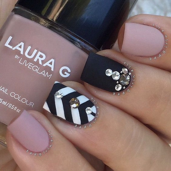 >Matte Nail Design with Chevron Patterns.