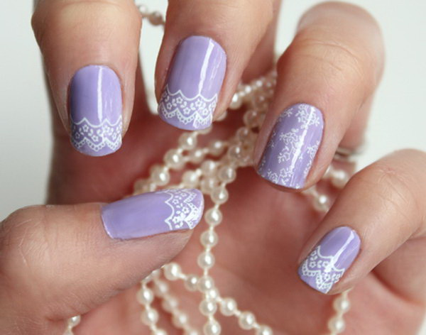 Purple and white lace nails.