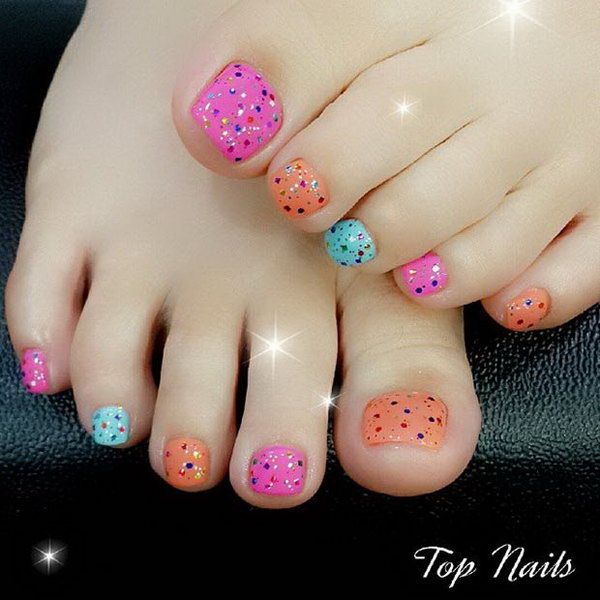 colorful toe nail design with glitters for accent