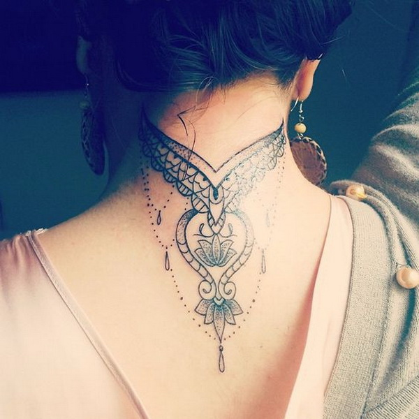 Delicate Tattoo on Back of the Neck.