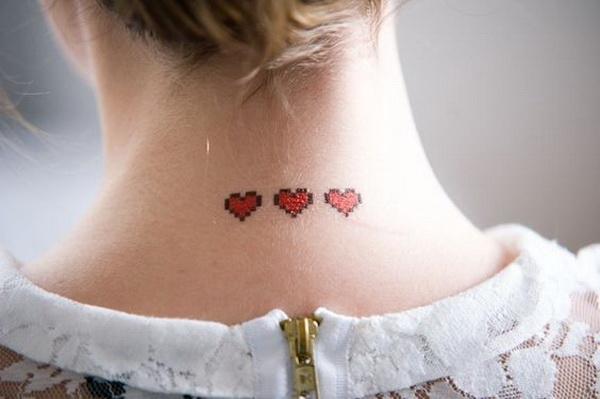 Three Mini Red Hearts Tattoo On Back of Neck.