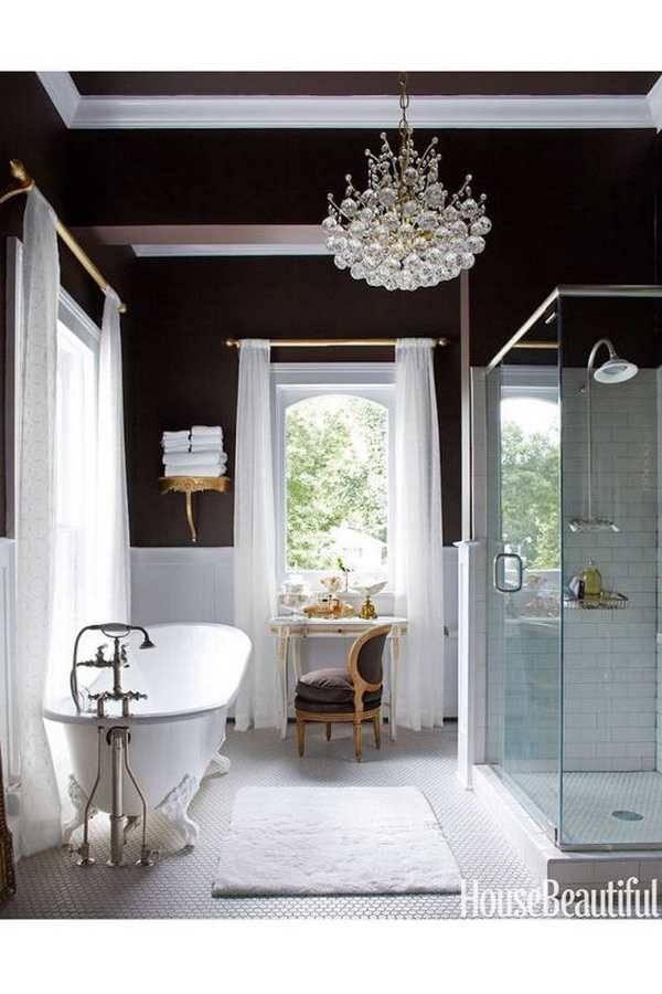 Look at this glamorous modern bathroom designs! Chandelier, dark walls, vanity with natural light...Just love everything this gorgeous space!