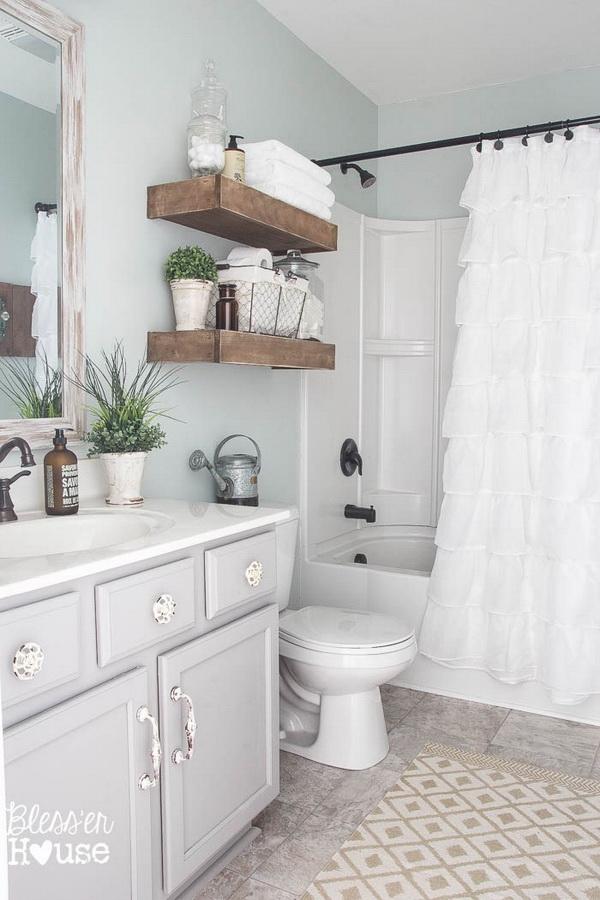 Modern Farmhouse Bathroom with Wood Floating Shelves.