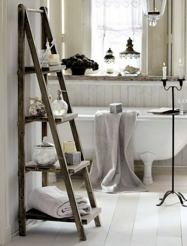 The old wood ladder creates a good bathroom storage and adds more rustic warm to this farmhouse bathroom.