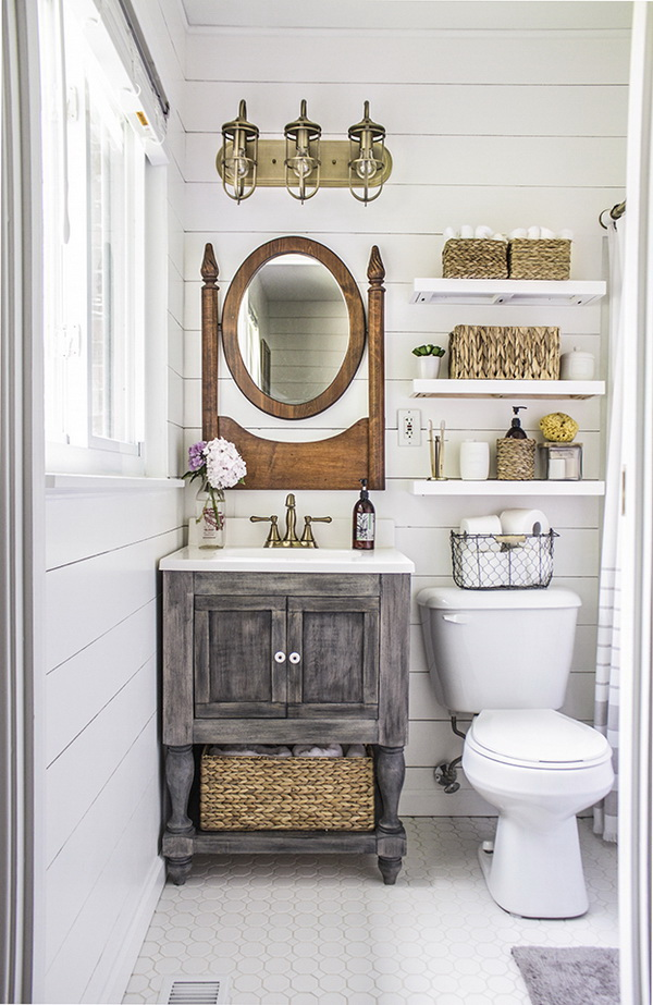 The floating shelves above the toilet provide great storage solution for bathroom supplies!