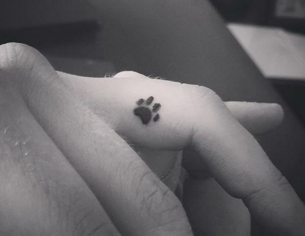 Dainty Dog Paw Finger Tattoo.