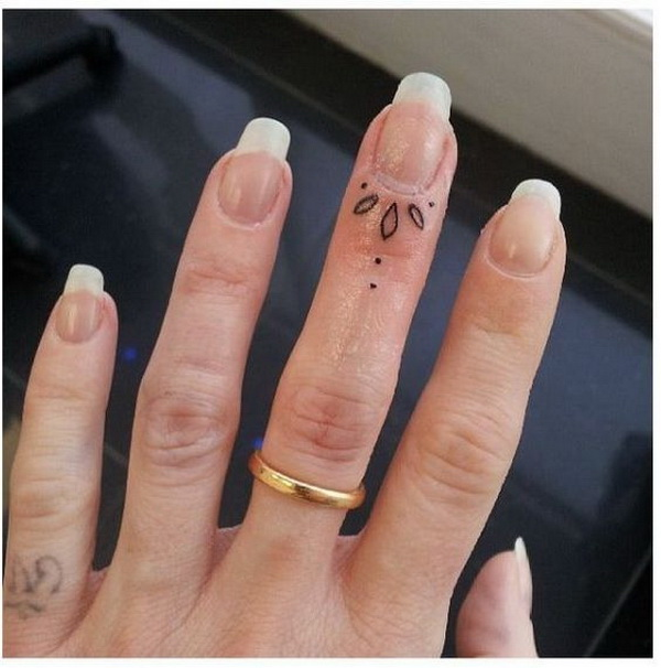 Pretty Finger Tattoo Design.