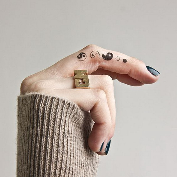 Yin Yang Tattoo On the Inside of Finger.