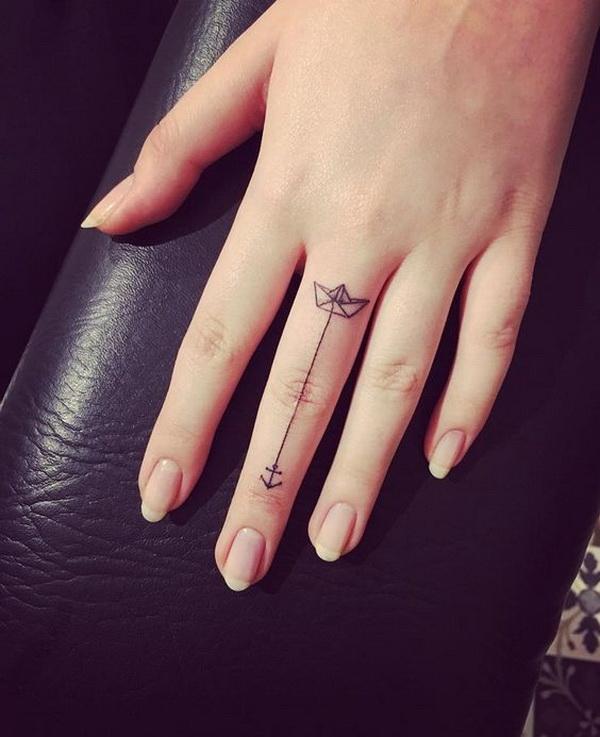 Paper Boat & Anchor Minimalistic Finger Tattoo .