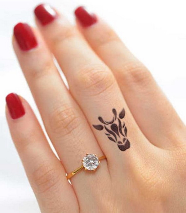 Elegant Finger Tattoo Design.