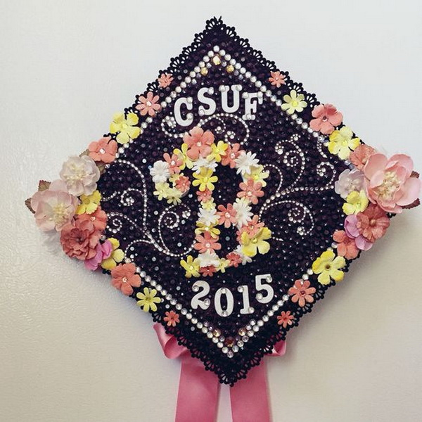 White and Pink Daisies Decorated Graduation Cap---40+ Awesome Graduation Cap Ideas.