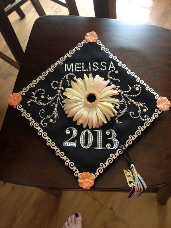 Daisy Flower and Pearls Decorated Graduation Cap---40+ Awesome Graduation Cap Ideas.