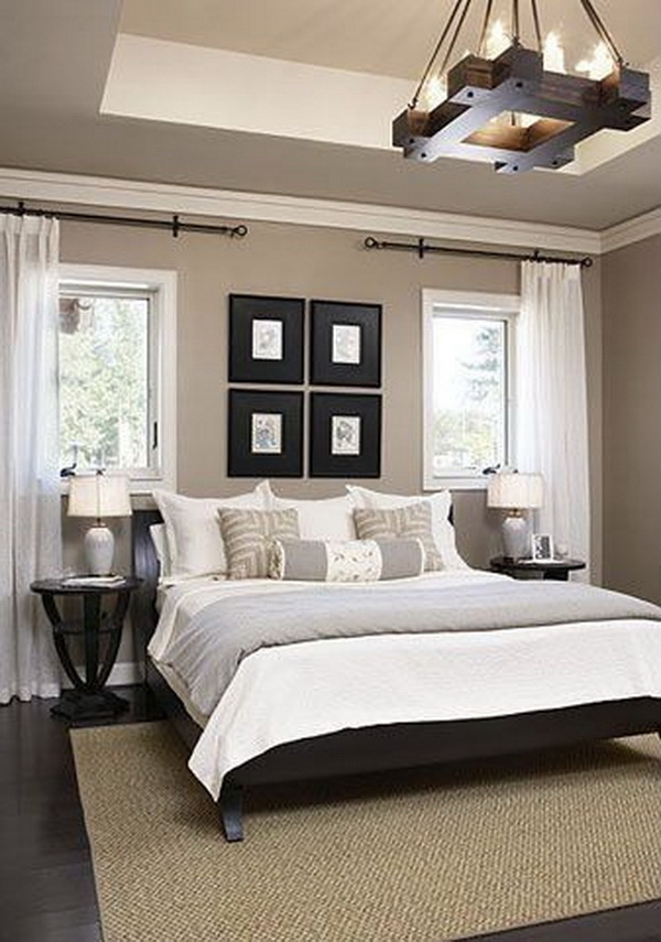 Clean and simple White, gray and beige master bedroom. Love the rustic chandelier!