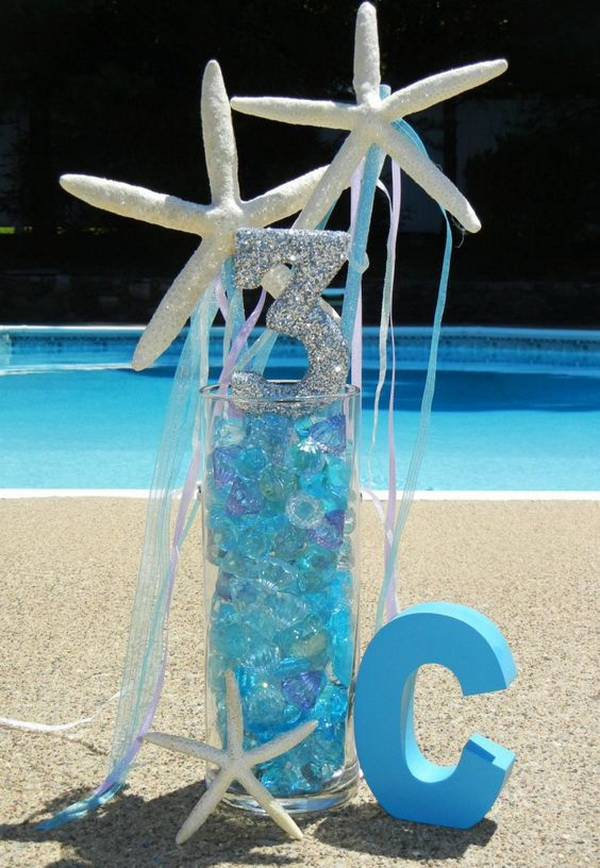 Party Table Centerpiece with Starfish and Numbers.