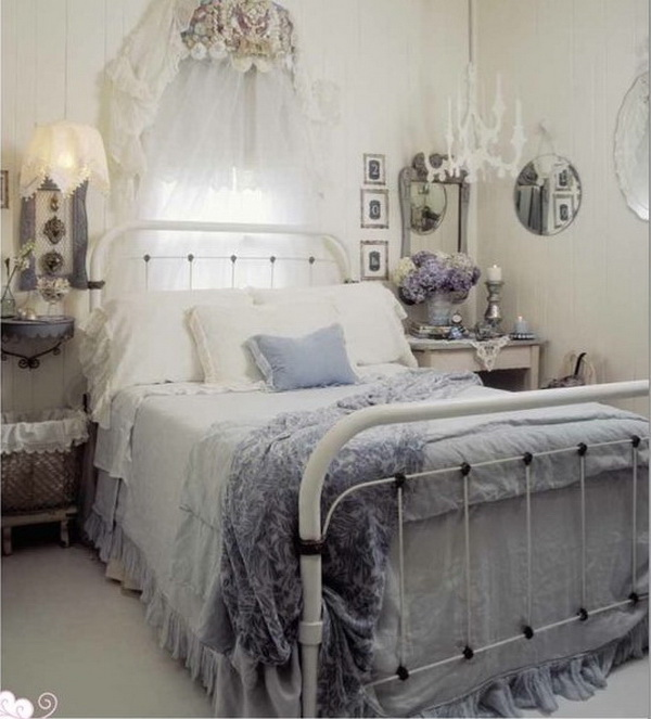 romantic shabby chic bedroom with fairy lights over headboard and