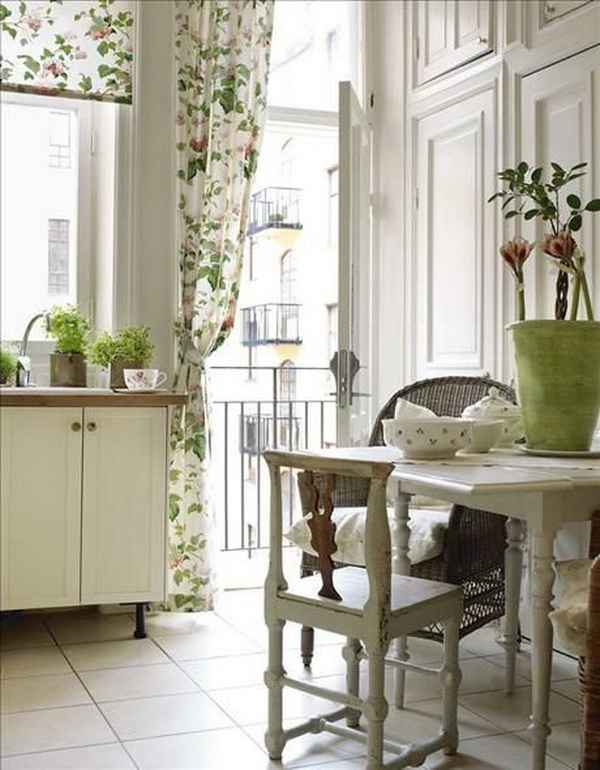 Country Shabby Chic Kitchen Decor with Beautiful floral fabric and Green Plants.