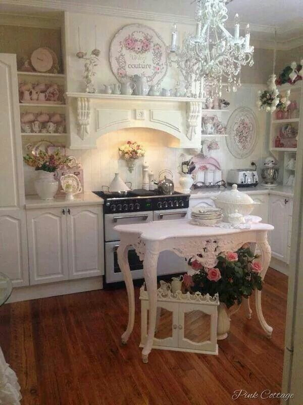Shabby Chic Kitchen With A Small Pink Island In Center