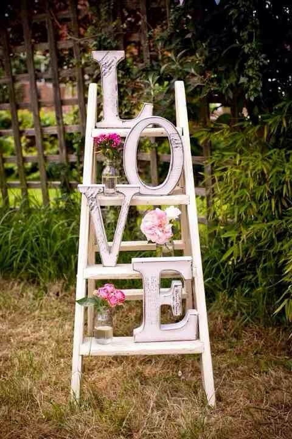 Vintage Ladder for Love Letters Display with Fake Flowers in Jars.