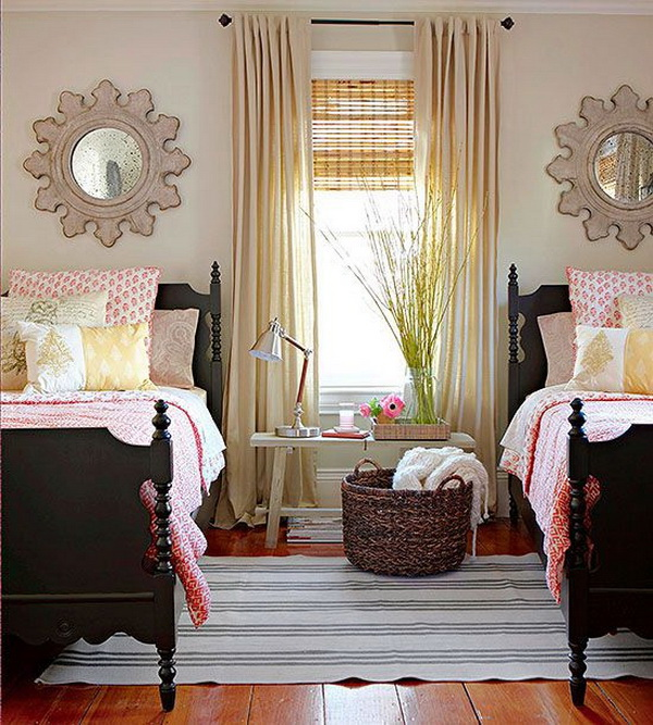 Beige painted walls and dark brown antique beds for a shred bedroom for teen girls.