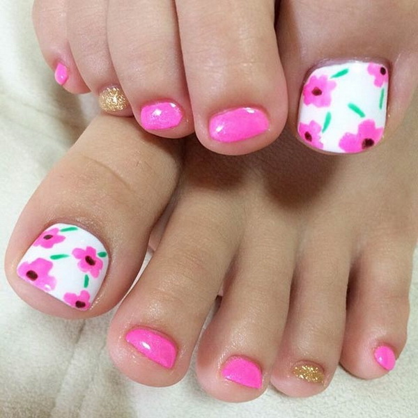 Pink Floral Toe Nail Design With A Bit Of Gold Glitters