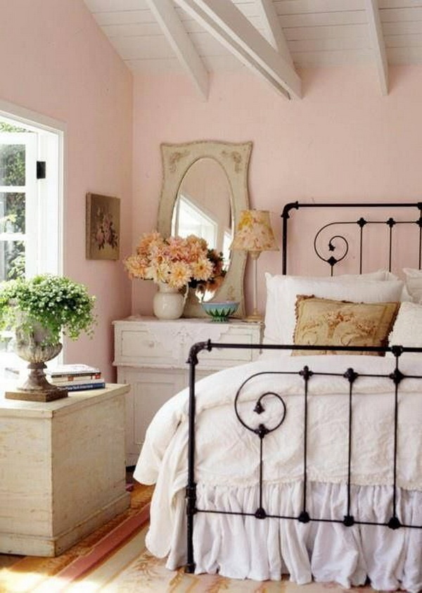 Cute, Feminine Bedroom with Soft Pink Walls and Iron Bed.