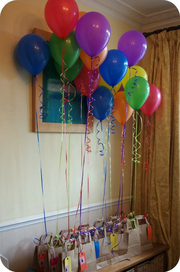 Tie Balloons to Favor Bags.