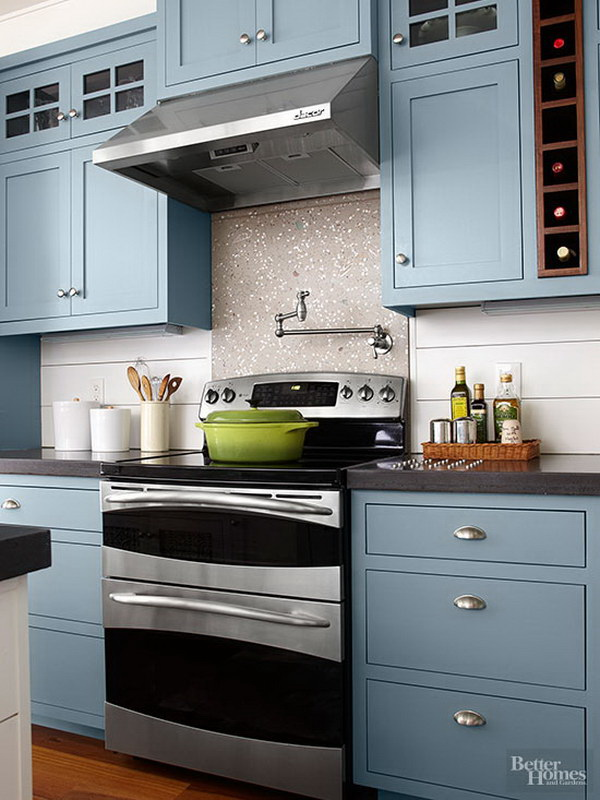 Electric Blue Kitchen Cabinets Paired with Steel Furnishing.