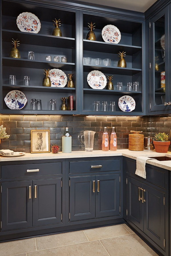 Lush Navy Blue Open Cabinetry with a Graphite Blacksplash.