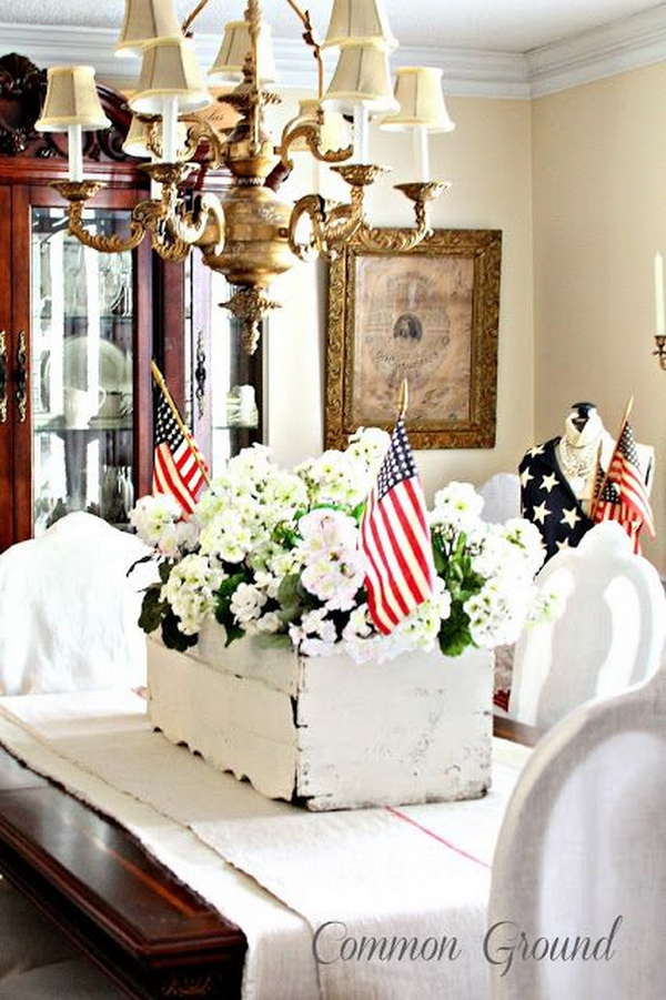 Fill the white carnation together with an American flag in a whitewashed planter box for the Independance Day table decoration!