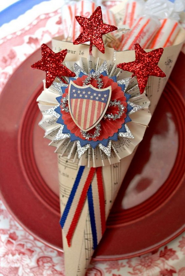 Make these paper cones with old music sheets and decorate with Patriotic ornaments for an easy table decoration on 4th of July!