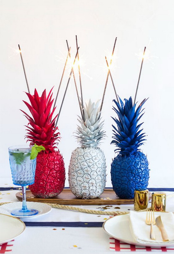 Take three faux plastic pineapples and spray paint them in red, white and blue separately! You can also add some fireworks on top for decoration as you like!