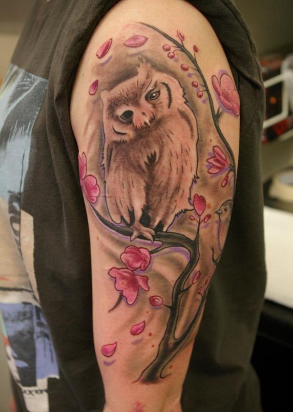 Owl with Cherry Blossoms Tattoo. More via http://forcreativejuice.com/attractive-owl-tattoo-ideas/