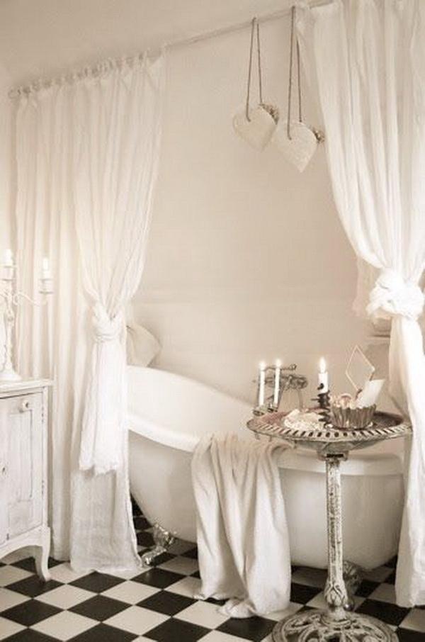 White Shabby Chic Bathroom with a Bird Bath as Bathroom Tub Table.