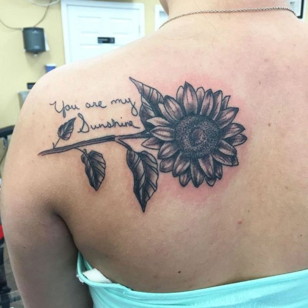 Black Sunflower Tattoo On shoulder. Looks amazing!