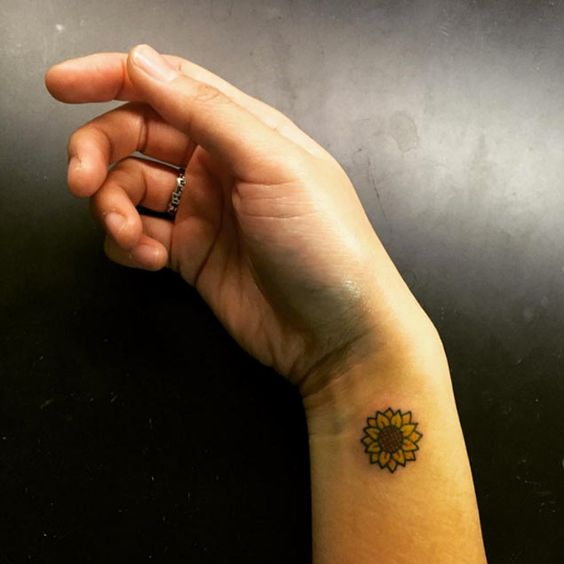 Tiny Wrist Piece: Pretty Sunflower Tattoo Design.