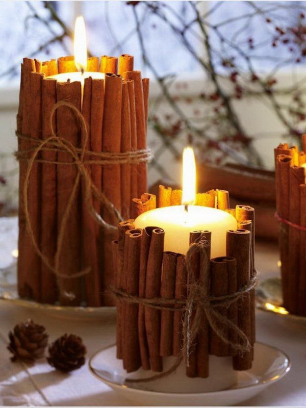 DIY Cinnamon Stick Candle Holder. Tie cinnamon sticks around the outside of your candles. It's so easy to make it yourself and makes your entire home smell amazing.