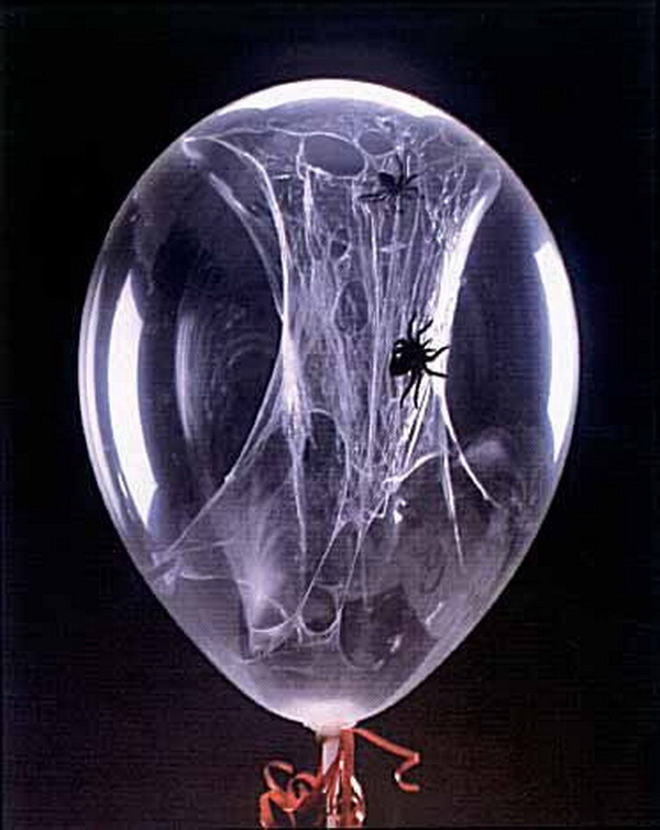 Spider Web Balloons. Decorating your home for Halloween by creating these easy spider web balloons.