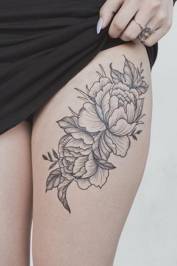 Peony flower thigh tattoo.