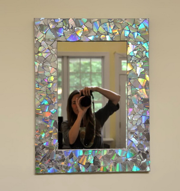 DIY Iridescent Mirror Frame. Refurbish an old frame with colorful CD pieces for reuse in your home.