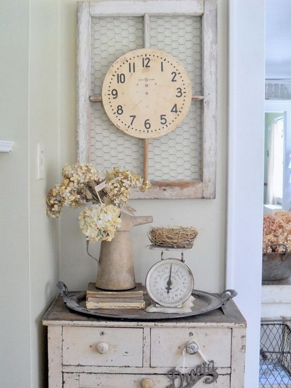 An old milk jag, a piece of clock and an old wire windows used to create rustic shabby chic touches.