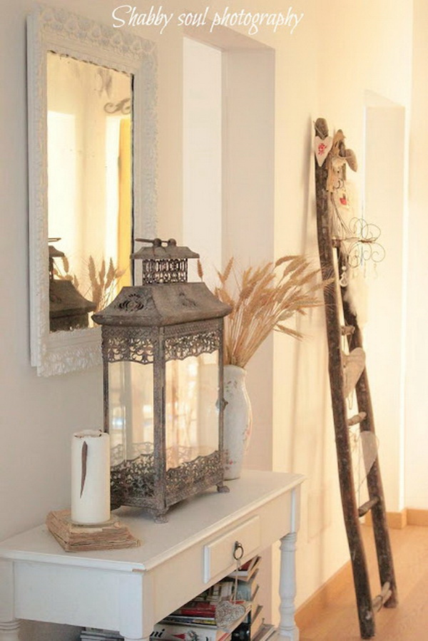 White entryway with wooden decor and a vintage metal lantern.