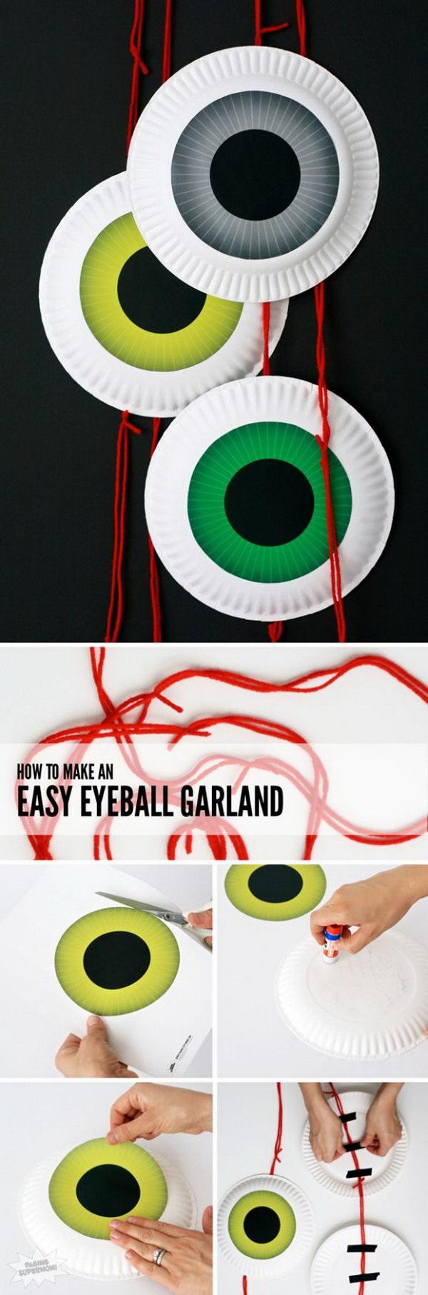 Cute DIY Halloween Eyeball Door Garland. Decorate your front door with these easy-to-make eyeball door garland this halloween season.