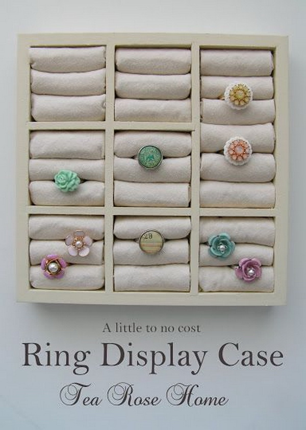 DIY Ring Display Case. Turn the wood frame from the dollar store and some fabric leftovers at home into a beautiful ring display case!