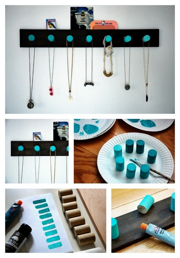 DIY Ombre Wooden Pegs. Drill a dowel into segments, paint each a shade of the same hue, then glue to a black backboard for an elegant jewelry hanger with a pop of color.